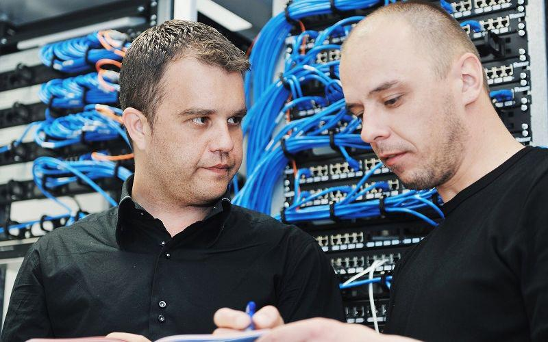 Technicians working onsite on an IT project